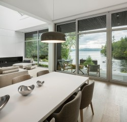 The-Slender-House-overlooks-the-lake-and-welcomes-the-outdoors-in