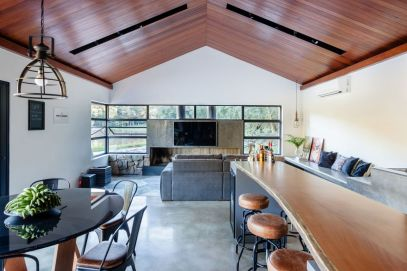 Lake-house-with-vaulted-ceiling-and-live-edge-table