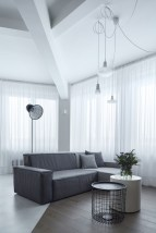 Prague-loft-features-breezy-white-curtains