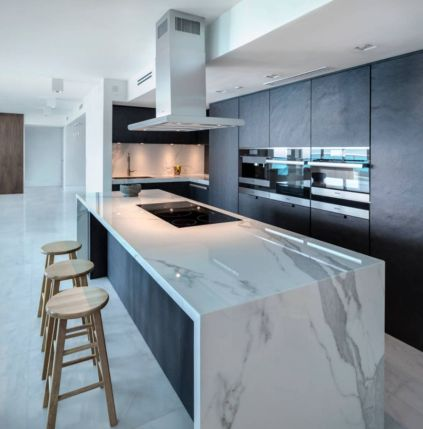 White-marble-with-gray-veins-kitchen-island