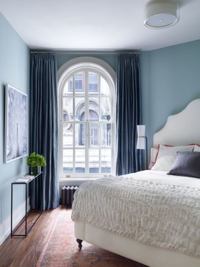 Blue-paint-small-bedroom-and-large-curtains
