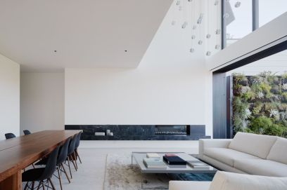Remember-House-living-room-with-marble-accents-for-fireplace