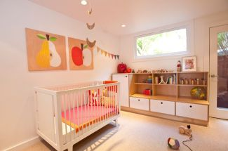 Mid-century-nursery-room-with-storage-boxes-and-fruits-for-wall-art