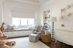 Nursery-room-with-built-in-shelves-for-storage