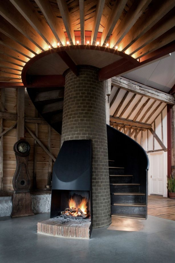 Old-barn-with-steel-spiral-staircase-around-fireplace