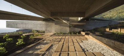Concrete-house-project-with-area-under-it-by-Felipe-Assadi-Arquitectos