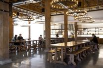 Large-tables-and-benches-encourage-people-to-sit-together-and-to-collaborate-in-a-relaxed-and-friendly-environment