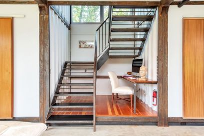 Adam-Kalkin-Shipping-Container-Home-steel-staircase-with-desk-under