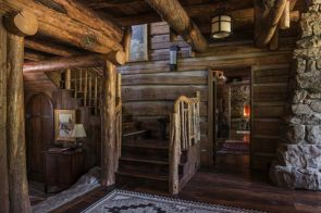 Rustic-mountain-residence-in-in-Teton-Valley-Wyoming-natural-wood-stairs