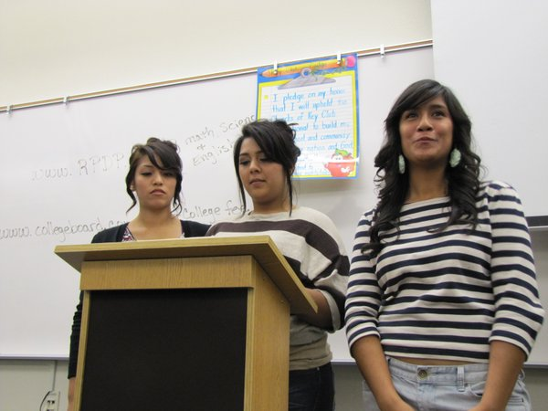 Students make an announcement at a weekly Hispanic Student Union meeting.