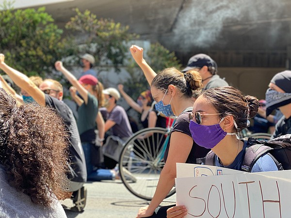 Protesters march through downtown San Diego in solidarity...