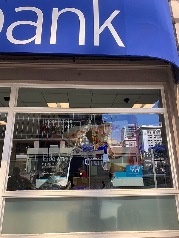 A broken window is pictured at a Citi Bank branch in down...