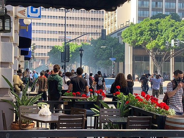 Police fire tear gas into a crowd of demonstrators in dow...