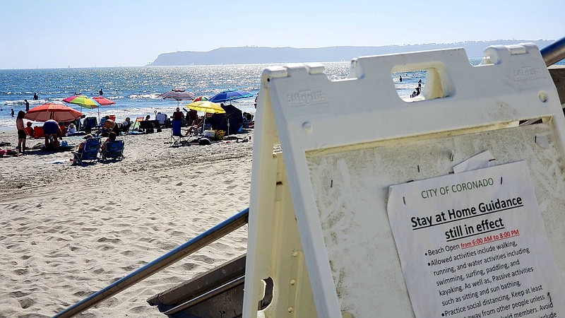 A sign in Coronado reminding residents the stay at home guidance is still in ...