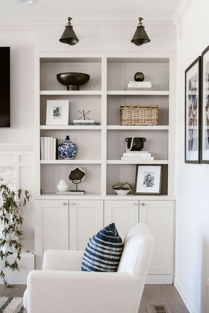 white built in shelving in living room