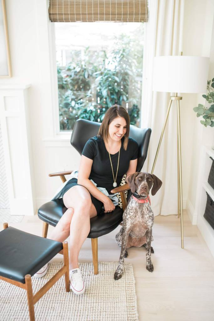Krissy Peterson at home with her dog