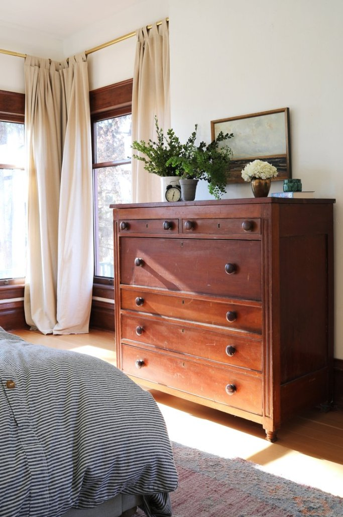 A vintage dresser in a master bedroom.