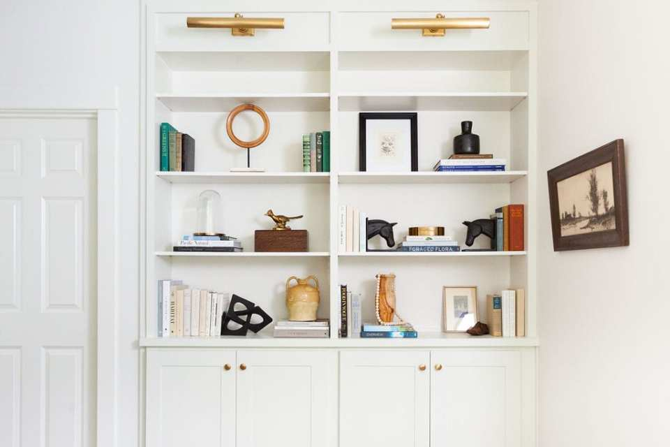 white built-in shelving with books and decorative accessories