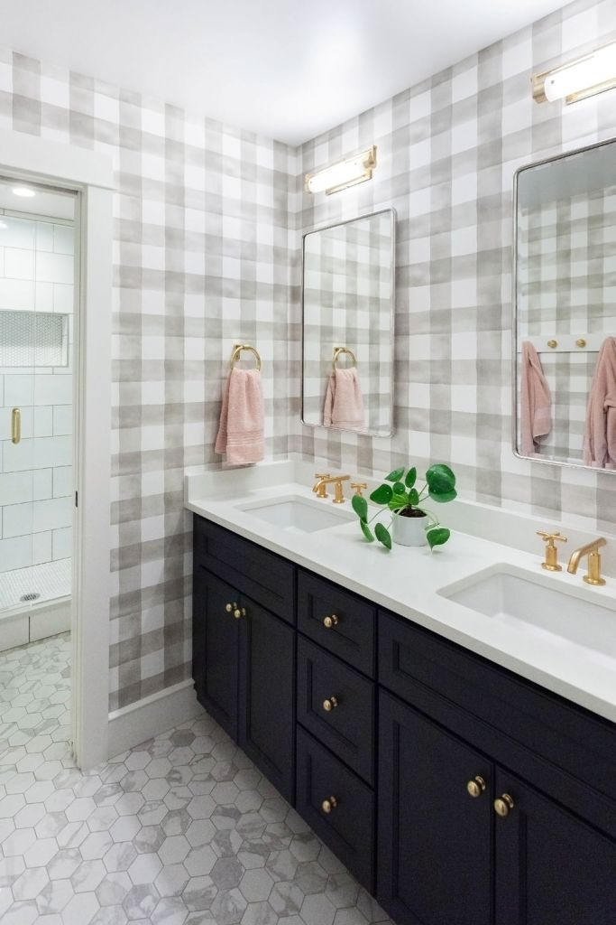 navy cabinets in bathroom with gold knobs