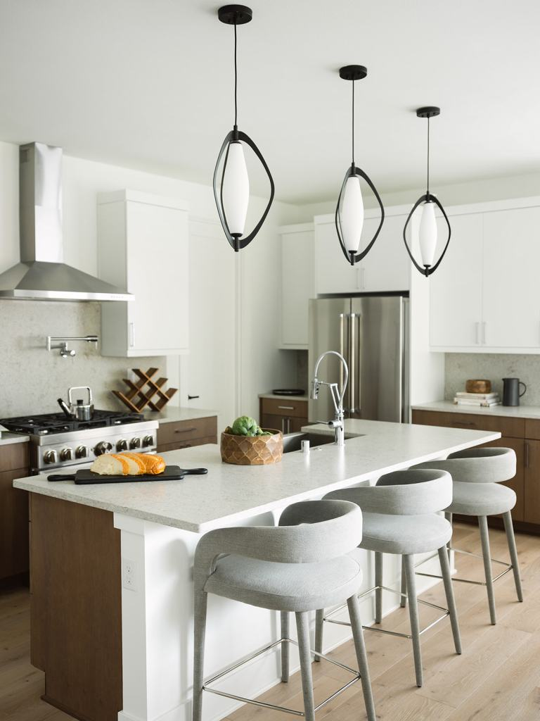 modern pendant lights and barstools in kitchen
