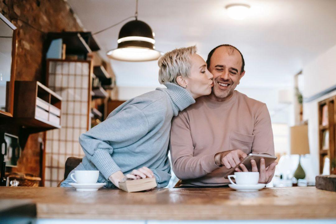women appreciating her husband over coffee