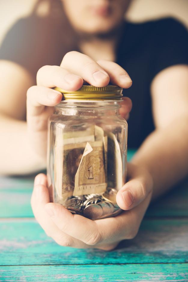 holding a savings jar