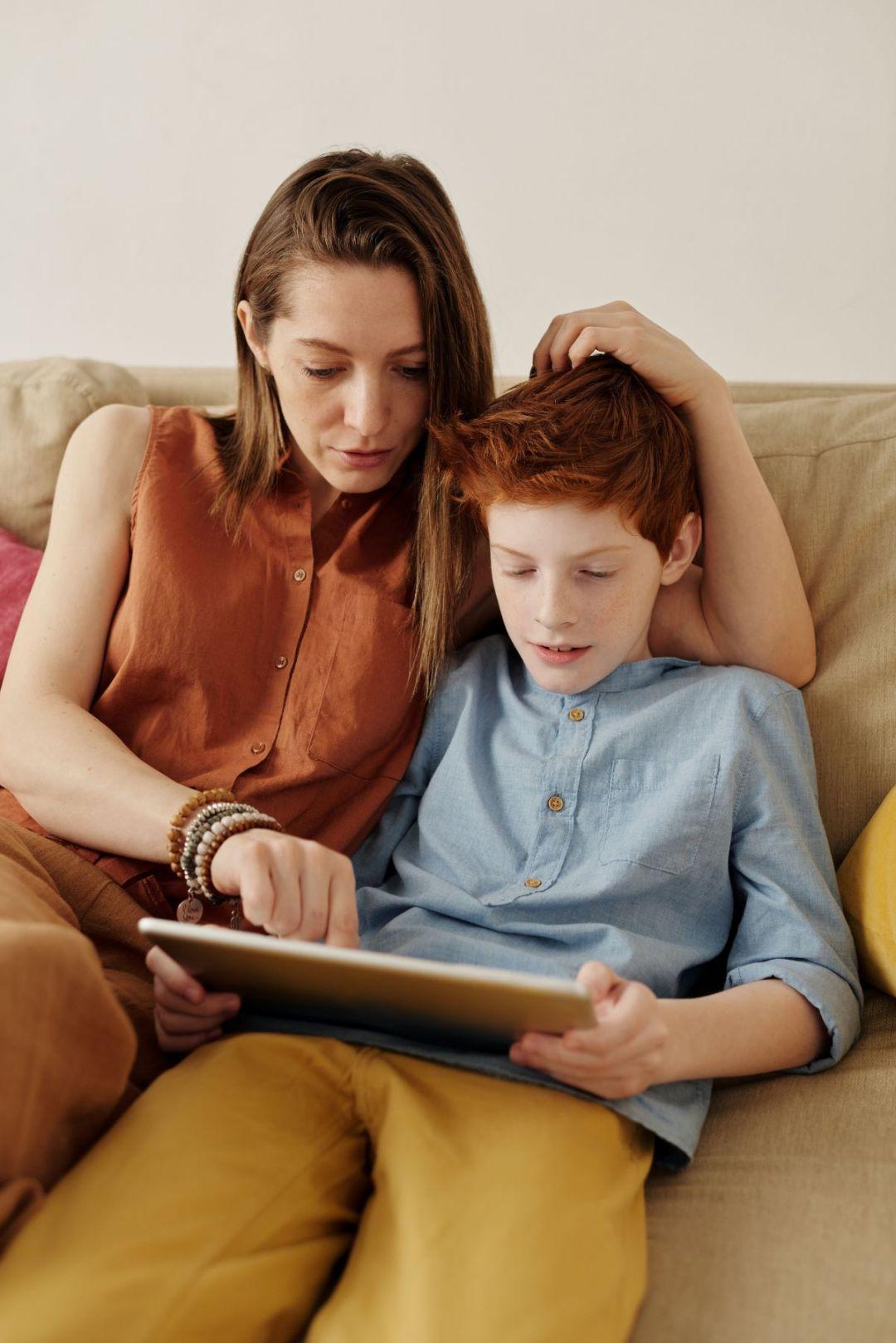 Mother helping son adjust to online school