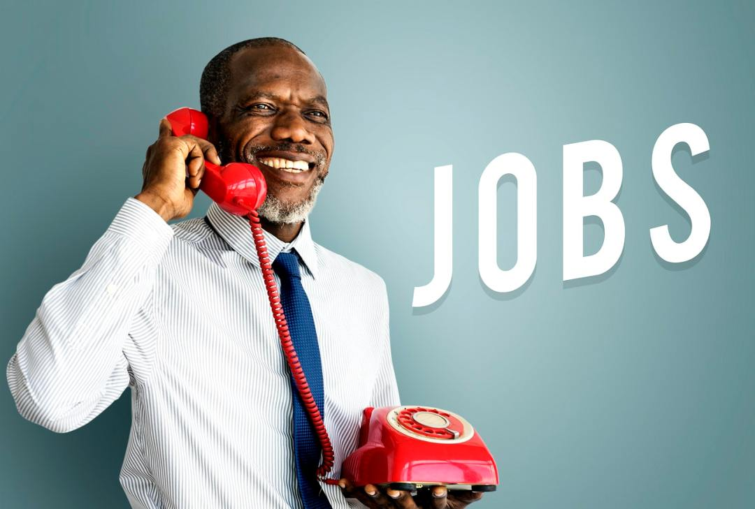 middle aged man on phone calling jobs