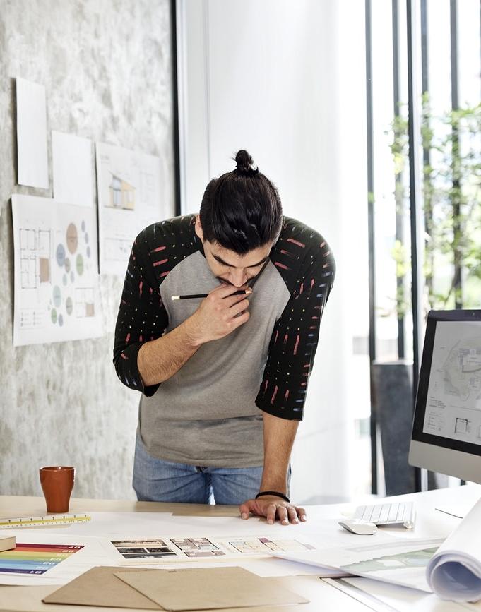 Indigenous Man working on designs