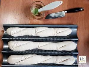 Brush your baguettes with water