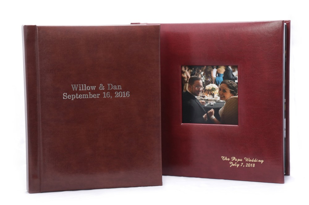 8×10 Leather album with front center inscription compared to 10×10 leatherette album with cameo cut-out and front lower right corner inscription
