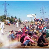 UP migrant workers 'sanitised'  by chemical bath on road