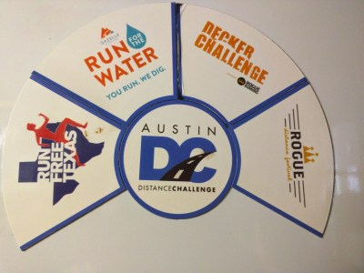Austin Distance Challenge magnets with four of the six races completed.