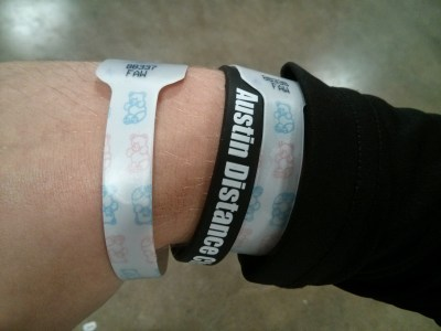 Wearing my dual hospital bands with my Austin Distance Challenge bracelet.