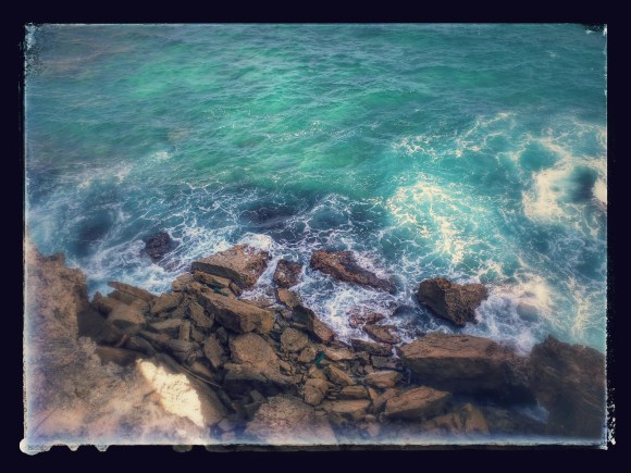Looking off of a cliff, near Makawehi Bluff, Koloa, HI. Auto-edited by Google :)