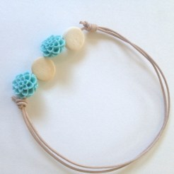 Cabochon flower beads and round kenyan beads.