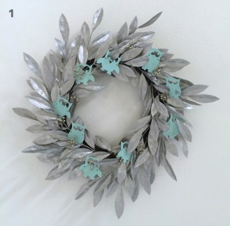 Decorate a neutral color wreath with small objects or cut outs that complement your party's theme.