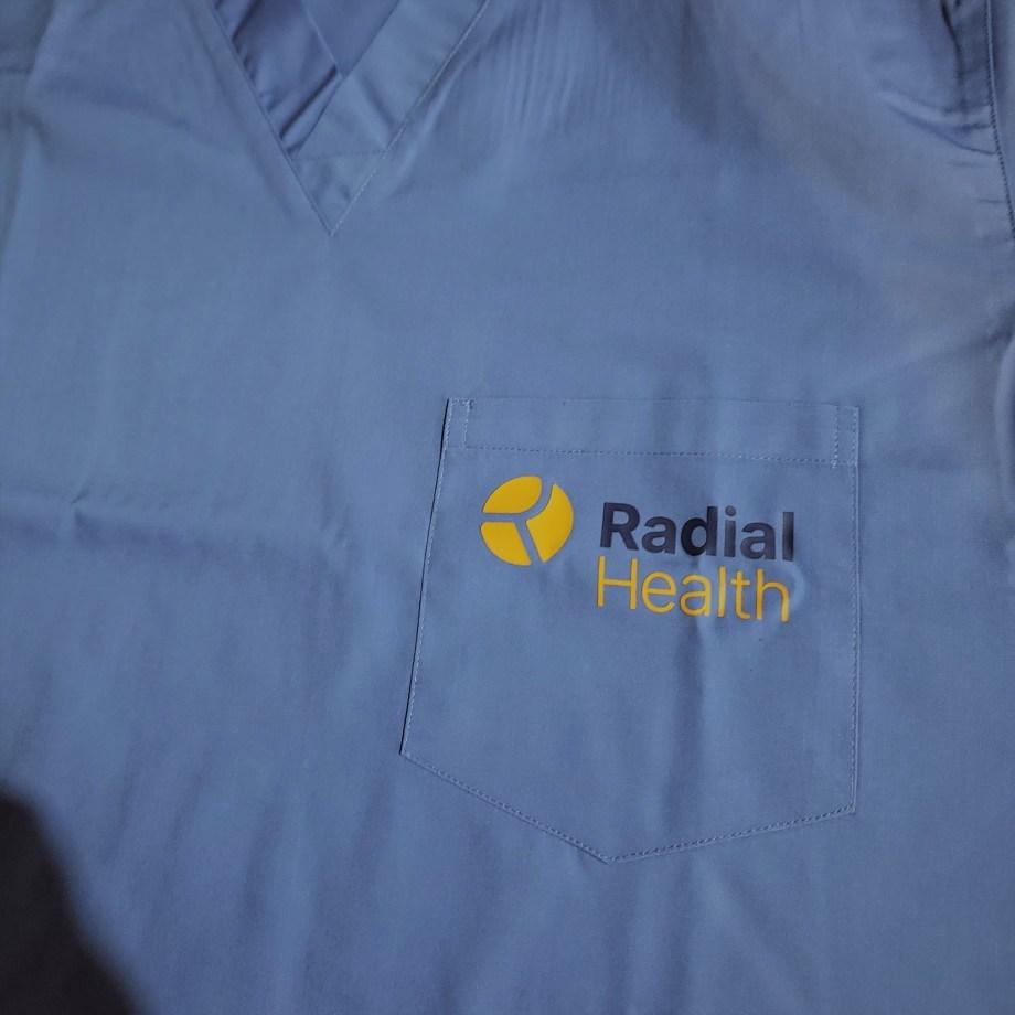 Radial Health logo on scrub top