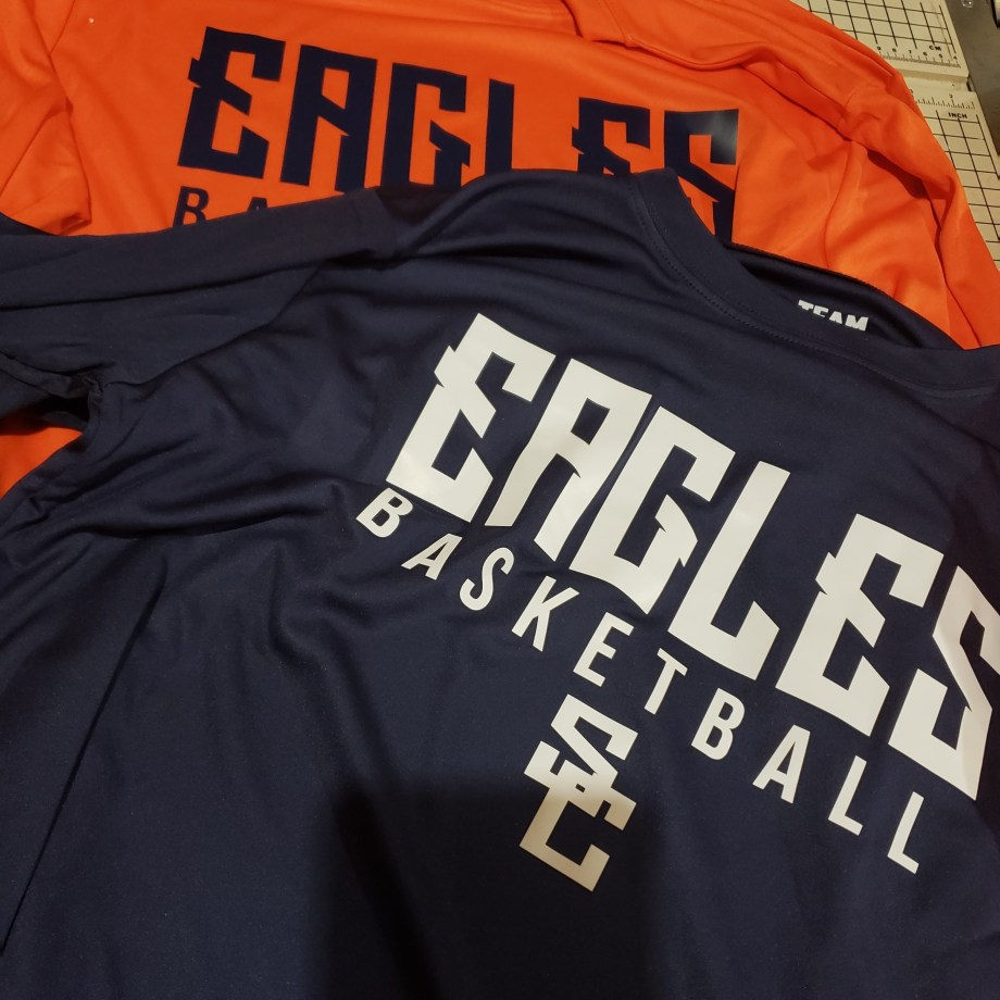 Two Eagles Basketball t-shirts, one orange, one navy blue