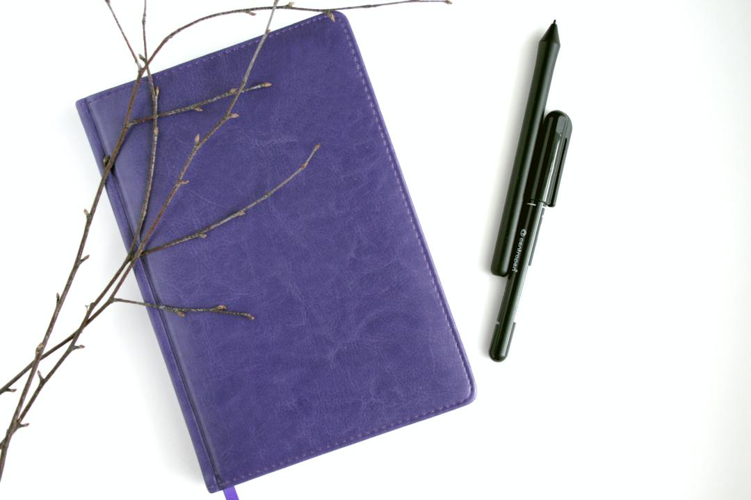 a journal and pens