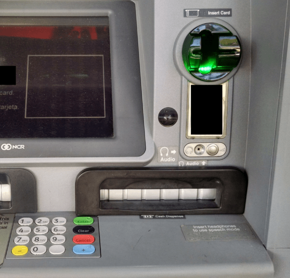 Although it's difficult to tell from even this close, this ATM's card acceptance slot and cash dispenser are both compromised by skimming devices.