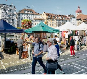 Lucerne flea market stalls along the Reuss river
