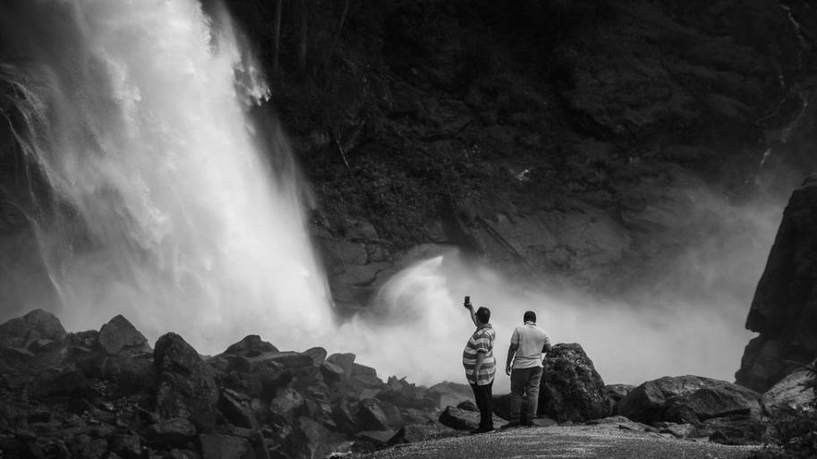 two man photograph the third waterfall casced in Krimml (Darkfall Series)