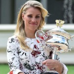 Angelique Kerber poses with the women's singles trophy at Government House, 31 January - Ben Solomon-Tennis Australia
