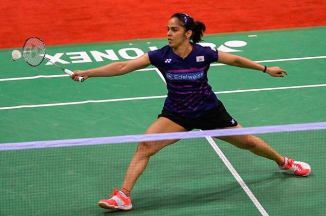 Sania Nehwal of India returns a shot against PV Sindhu