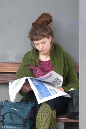 Girl reading on railway platform