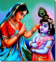 Mother Yashoda chastising baby Krishna