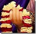 Radharani holding a flower garland