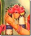 Sita holding victory garland