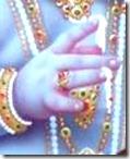 [Krishna's hand]